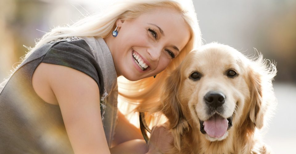Happy And Cheerful Woman With Her Dog.